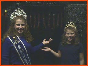 2001 Miss Teen Andouille and younger sister 2001 Little Miss Andouille show the Andouille in the smokehouse
